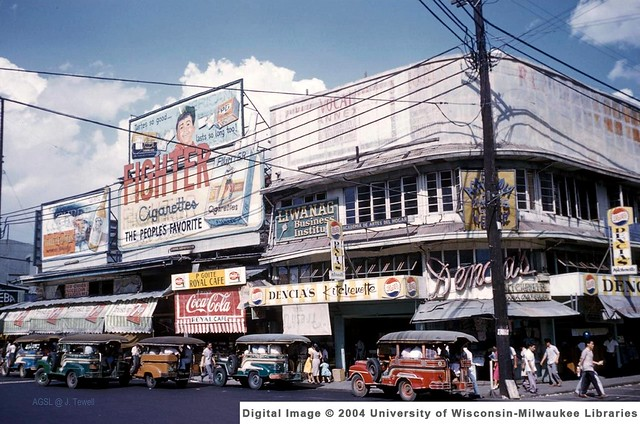 Manila, Philippines, Jeepneys parked along the street, 1950s-1960s