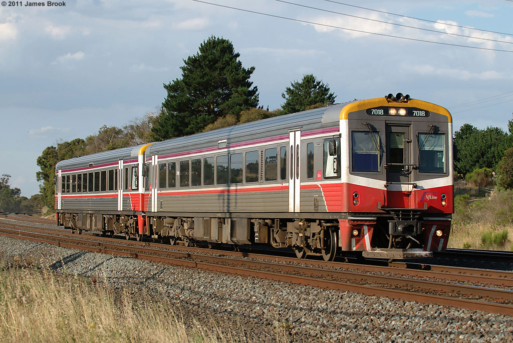 7018 and 70-- with 8332 at Kilmore East by James Brook