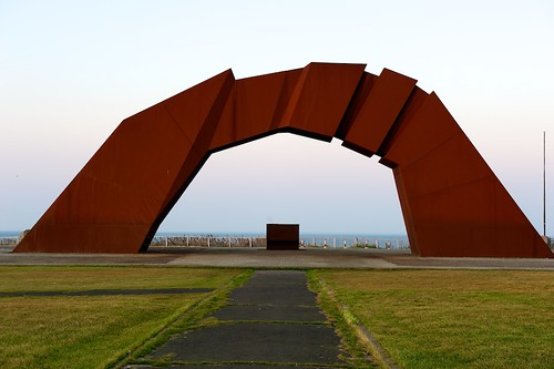 ocean sunset monument grass fence arch outdoor