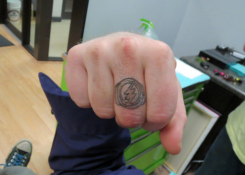 I got the Flash ring tattoo on my finger touched-up by Rick Kutch at No Regrets Tattoos