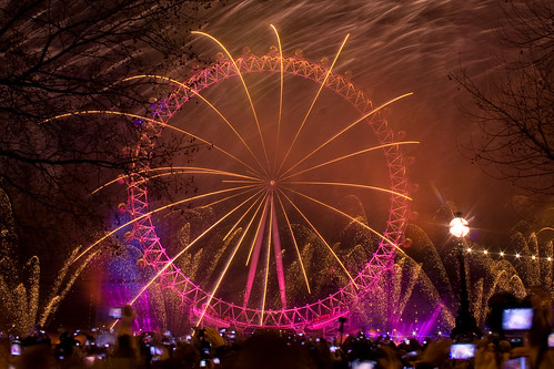 Fireworks are fired from the EDF Energy London Eye to mark the start of London's Olympic Year.  Thousands of revellers lined the streets of London to celebrate.London, UK. 1st January 2012.   by Paul Brock Photography