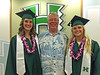Diving coach Mike Brown with divers Lauren Hall, left, and Aimee Harrison at the University of Hawaii at Manoa spring commencement ceremony on May 14, 2016.