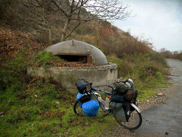 Bicycle and bunker -- according to Elvin, Albania built 800,000 bunkers for its 900,000 citizens (at the time) by bryandkeith on flickr