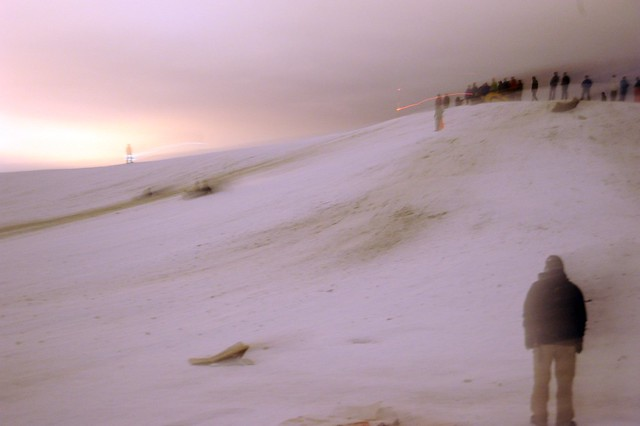 Mystical level of sledding and skiing, light, watchers, top of the hill, clouds, snow, Gas Works Park, Seattle, Washington, USA