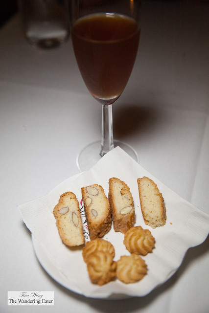 Vin Cotto and a plate of almond biscotti and butter cookies