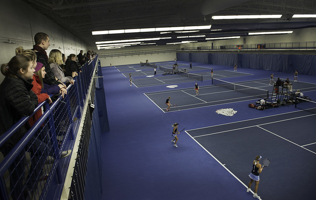 People playing tennis in the Stevens Center