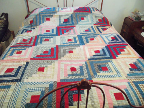 It's a clean, well-executed log cabin quilt top. Worth finishing and giving away.