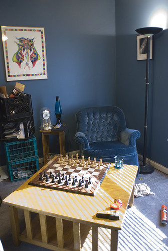 Half of the room becomes a place to think, eat lunch, and relax. My beloved college chair now has a home, as well as my chess set. There are still boxes of things to put away, but much progress has been made.