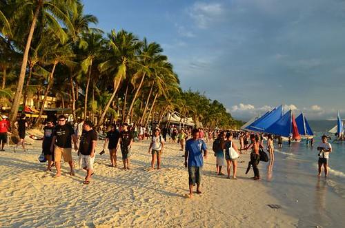 Boracay White beach full of tourists at sunset