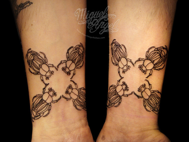 Bettle line work tattoo