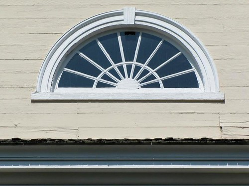 door roof house building home window motif architecture sunrise wooden columns entrance northcarolina front structure molding porch classical residence simple plain railings federal entry façade gable sunray steep transom semicircle dwelling segmented louisburg nationalregisterofhistoricplaces franklincounty sills unadorned nrhp pedimented georgianstyle sidelights doubleleaf louisburgcollege personplacepreservationsociety