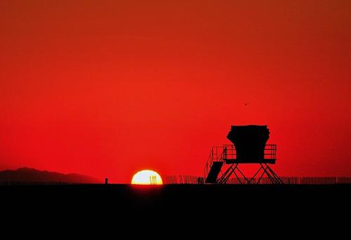 ocean california sunset red orange sun beach nature silhouette fence island catalina dusk huntingtonbeach lifeguardtower