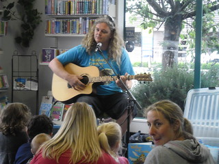 Craig playing his guitar | by Christchurch City Libraries