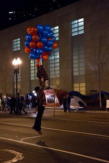 Occupier Hanging from Balloons Over Atlantic Avenue at 12_9_11 All-Night Rally to Stop #OccupyBoston Eviction