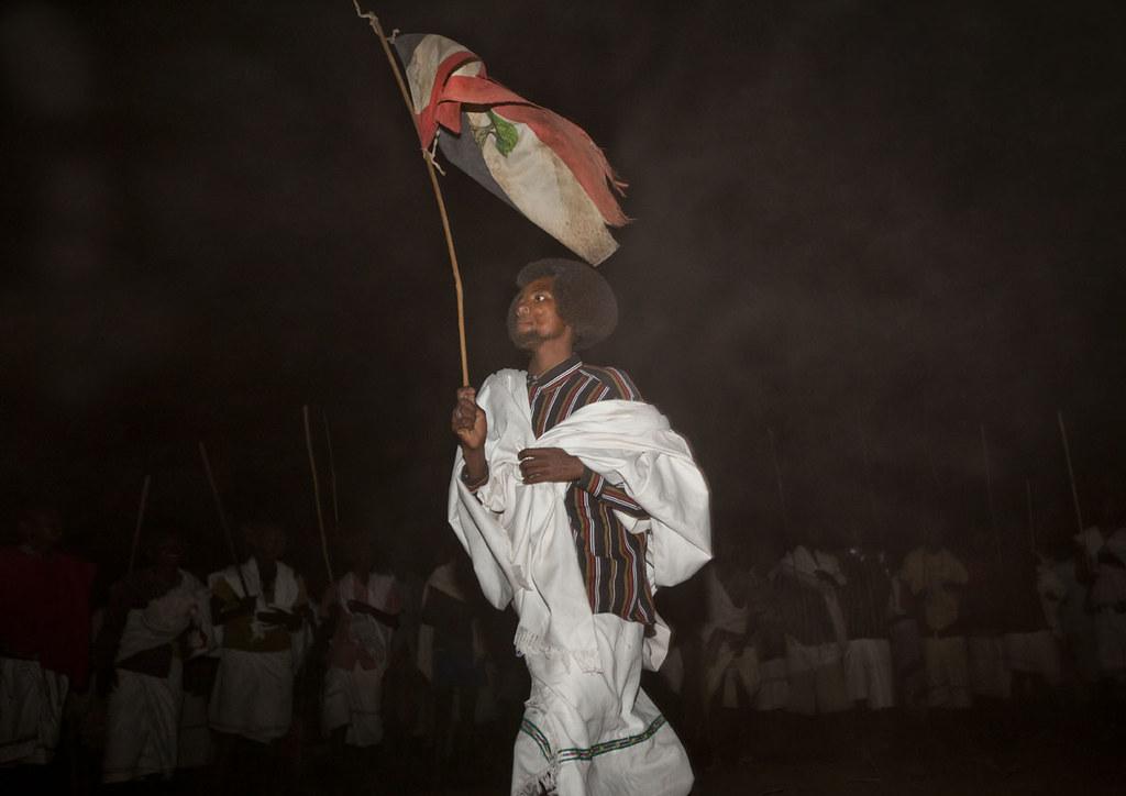Karrayyu warrior with Oromo flag in Gadaa ceremony - Ethio