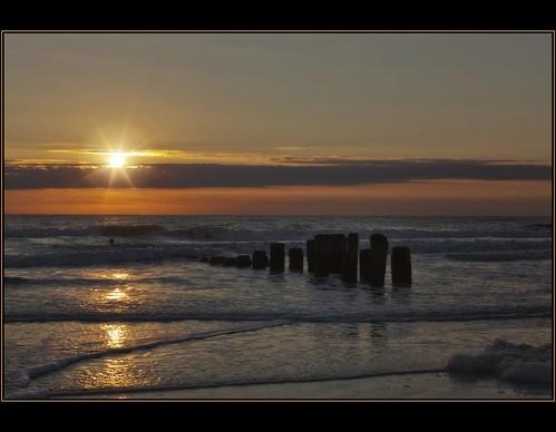 sky sun beach yellow sunrise golden coast nc waves glow northcarolina explore sunburst pilings carolinabeach seafoam goldenglow paulmalcolm fiddleflix starefex topazstarefexsilhouette