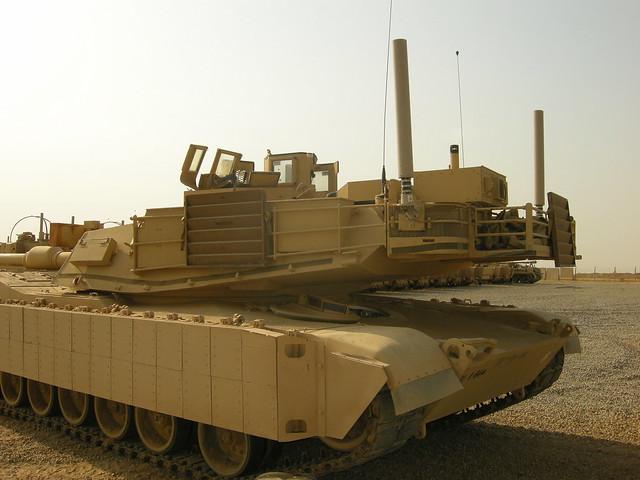 Sitting on an M1 Abrams tank