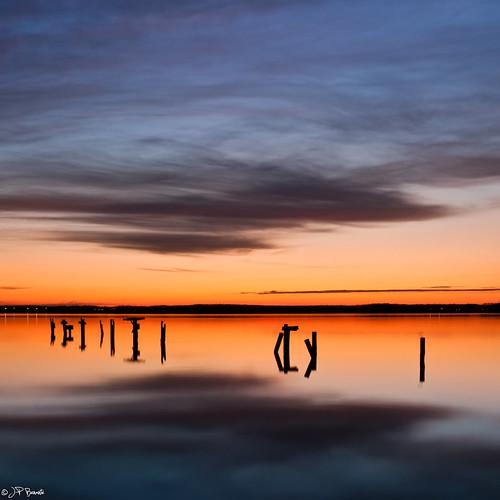 longexposure blue winter orange reflection water silhouette clouds sunrise virginia pier horizon maryland shore pylons leesylvaniastatepark simplesong