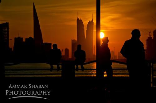 city sunset sea sky people urban panorama sun reflection colors silhouette clouds bahrain manama muharraq