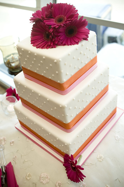 Simple cake with dots and fresh gerbera daisies