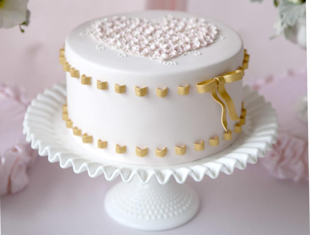 Gold ribbon birthday cake