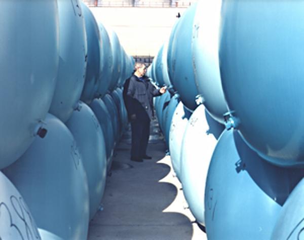 OR14 210   A Storage Yard Worker Between Two Rows of Deplete