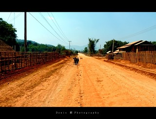 Dusty Huts, Dusty Road, Dusty Kids...Dusty Dogs | by Denis Li