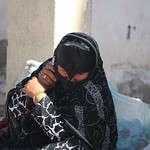 Sinaw, Bedouin woman with mobile phone