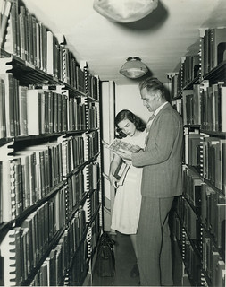 Faculty Member helping a Student in the Stacks, 1948 | by lizkentleon