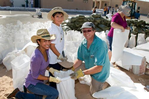 Volunteers fill sandbags to assist Santa Clara Pueblo in the aftermath of 2011's Las Conchas Fire