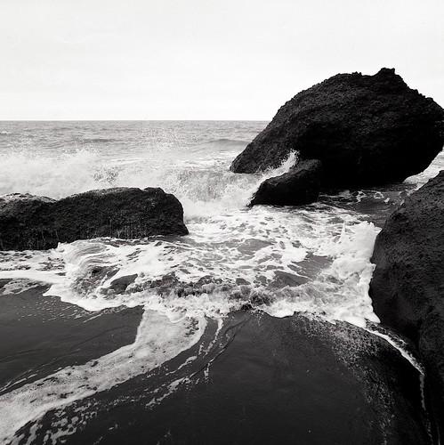 "Image titled ""Black sand and cresting waves, Vík beach, Iceland."""