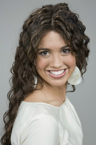 Long, curly brown hair  with highlights | by colourauthority.com