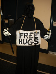 Death was giving away free hugs.  I got a hug.