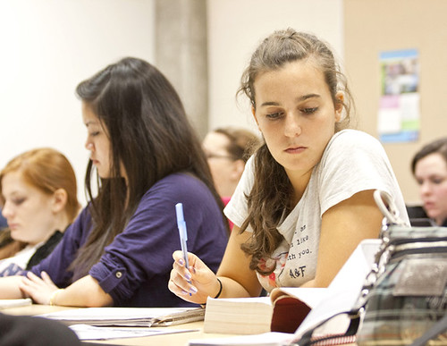 Student Contemplating Notes in Theology Class | by Newman University