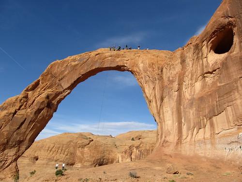 Rope Swingers, Corona Arch, Near Moab, Utah   by Ken Lund