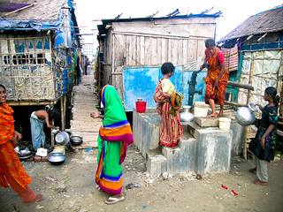 Women queueing to get access to the raised tube well