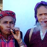 Women smoking in the Maubisse Sunday market, Timor Leste