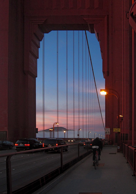 Cyclist on Golden Gate Bridge at sunset.  San Francisco (2012)