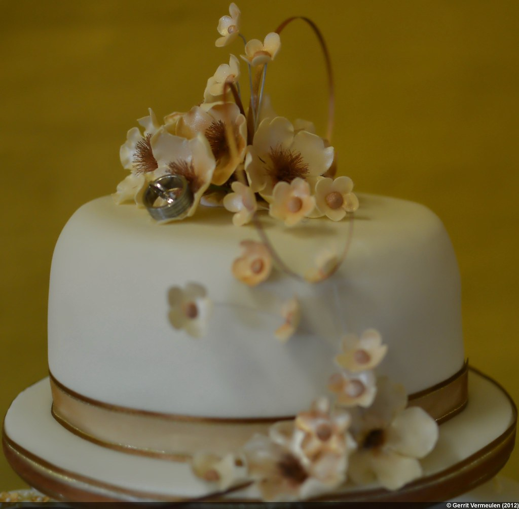 Flowers, rings, and cake