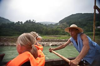 Boatman rows sampan on Shennong Stream   by retrotraveller