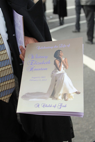 Whitney Houston funeral guest showing program to journalists | by Explorations Media, LLC