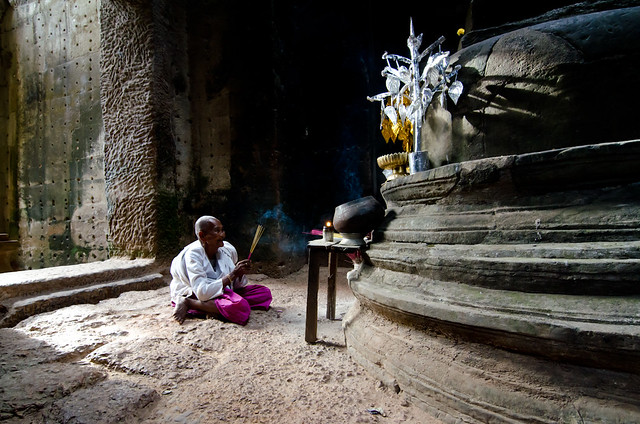 Buddhist Nun In Prayer at the Preah Khan Temple