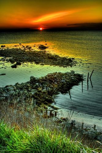 orange sky massachusetts beach manomet water rocks sunrise