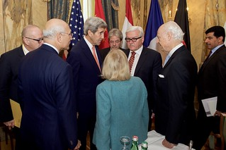 Secretary Kerry Chats With Attendees Before Group Discussion in Austria About Syria