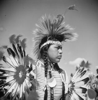 Young man dressed in regalia / Jeune homme portant des vêtements de cérémonie