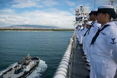 Crew members aboard USNS Mercy (T-AH 19) man the rails as the ship prepares to moor at Joint Base Pearl Harbor-Hickam. (U.S. Navy/MC3 Trevor Kohlrus)
