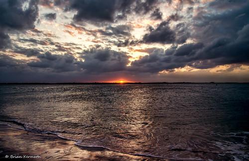 centralflorida pentaxk5 sunset atlantic atlanticocean ocean reflections reflection water beach florida floridabeach sky skies sun clouds waves tide dramaticsunset ponceinlet newsmyrnabeachflorida playa litoral coast shore seaside sea seascape landscape