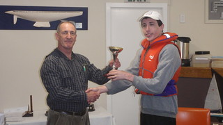 Andrew Coffin receiving the trophy for most improved junior | by PLSC (Panmure Lagoon Sailing Club)