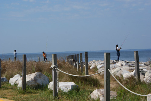 Fishing off the causeway at Point Lookout State Park, Scotland