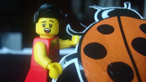 A Lego minifigure reads an ftt ladybird's mind